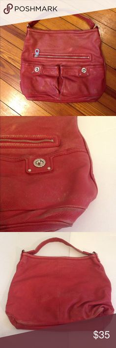 """Marc by Marc Jacobs red leather purse Marc by Marc Jacobs red leather purse red with silver tone hardware, 3 front pockets, 1 zipper pocket inside and 2 slit pockets inside. Inside is in good condition. 16"""" across, 13"""" high, 6.5"""" wide.The outside shows a lot of wear as seen in pictures priced accordingly Marc by Marc Jacobs Bags"""