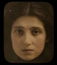 Woman's face by George Eastman