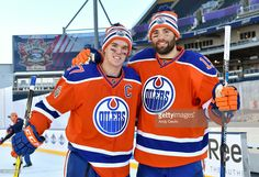 Connor McDavid #97 and Patrick Maroon #19 of the Edmonton Oilers pose for a photo during practice in advance of the 2016 Tim Hortons NHL Heritage Classic game at Investors Group Field on October 22, 2016 in Winnipeg, Canada.