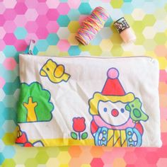 Hello kitty Sanrio upcycled pencil bag!  Check out this item in my Etsy shop https://www.etsy.com/listing/95754832/sanrio-little-clown-hello-kitty-circus