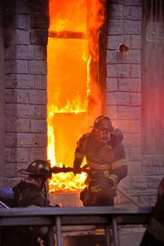 Baltimore City Fire Department firefighters battling a fully-involved structural fire.  (photo courtesy of BCFD 8x10)   Shared by LION