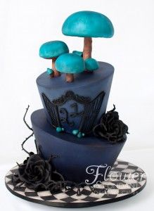 The theme for this 21st party was Tim Burton and the dessert table was themed around the Mad Hatters tea party in Alice in Wonderland. The dark colours angles, thorns and crazy iron gates are all themes found in many Burton movies, the mushrooms and tiled board have it that extra Alice touch. The colour of the mushrooms was heavily influenced by the Cheshire cat's eyes which are that same gorgeous glowing teal colour.
