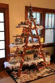 Unique way to display your Christmas village, nutcrackers, music boxes, snow globes, etc. Simple old ladder adds a rustic feel. Cover w/ lights and line shelves w/ fake snow to create a village scene.