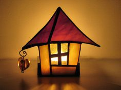 Stained glass candle house