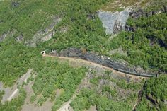 This photo shows the Flam railway snaking through the mountains, which you can experience for yourself on the 'Norway in a Nutshell' excursion.