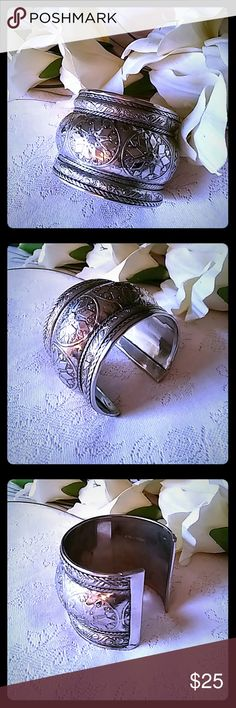 Vintage Ornate India Cuff Bracelet Silver tone metal cuff bracelet with a very ornate design. Very bold and?well made. Marked MADE IN INDIA on the inside with a?sticker. Jewelry Bracelets