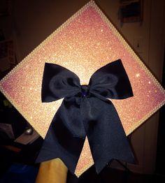 My graduation cap w/ black bow, pink glitter paper & pearl sticker lining the edges!