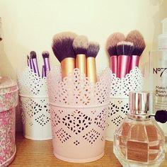 Adorable makeup brush holders.
