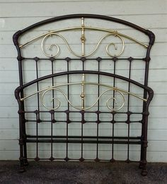 Beautifully arched Victorian with scrolled brass.