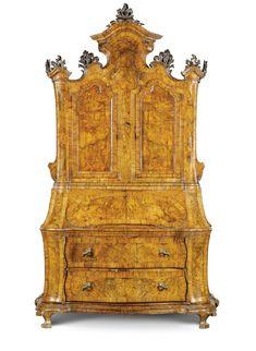 An Italian walnut and burr walnut bureau-cabinet, Emilian, after Venetian models,mid 18th century.