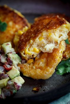 From Simply Delicious, cheesy corn cakes with spicy avocado salsa.