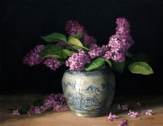 A floral oil painting of lilacs in a blue and white ginger jar.    Lilacs are now my favorite flower to bring inside and paint.  They make your entire home smell like springtime