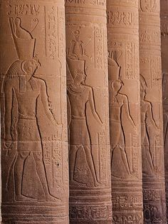 """Temple of the Goddess Isis at Philae (now on the Agilkia island), columns from the east side of the Open Court:from left to right, Harendote (""""Horus the Avenger of His Father""""), falcon-headed and wearing the Double Crown, Geb, wearing the """"Crown of Geb""""  Horus of Behdet (Edfu), falcon-headed and wearing the Double Crown with the two feathers, and Osiris, wearing the 'Atef'-Crown with the two feathers and ram's horns. ALL OF THEM ARE SHEMSU HERU"""