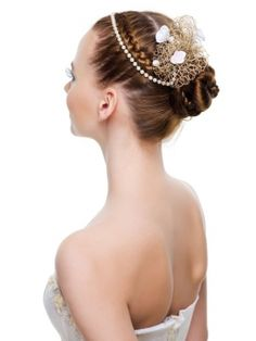 A tiara french-braid twists into a beautiful bun creating an intricate look on a simple hairdo.