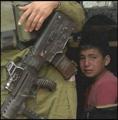 A frightened child in Gaza hides behind an IDF soldier…this sums up everything perfectly