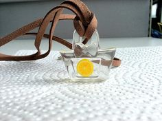 Orange in purse necklace
