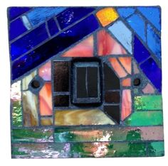 Light switch in blue, pink and green. Hand crafted in Murano and Tiffany stained glass. Size 9 x 9 x 1.5 cm. This mosaic light switch comes with matching screws and with UK approved standard electrical fitting. Size 9 x 9 x 1.5 cm. Please feel free to send me a message on Pinterest for commissions.