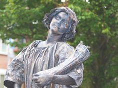 Levend standbeeld de Godin