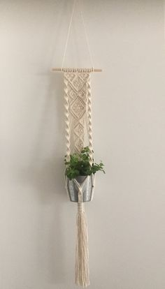 This wall plant pendant is handmade from beautiful ivory white cotton rope mm) and hangs on a white wooden stick. the suspension cord). The width of the wooden stick is 17 in. Macrame Wall Hanging Diy, Macrame Plant Holder, Wall Plant Hanger, Plant Wall, Deco Boheme, Macrame Design, Macrame Projects, Macrame Patterns, Decoration