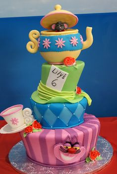 """Alice in Wonderland cake. We can help achieve this look at Dallas Foam with cake dummies, cupcake stands and cakeboards. Just use """"2015pinterest"""" as the item code and receive 10% off your first order @ www.dallas-foam.com. Like us on Facebook for more discount offers!"""