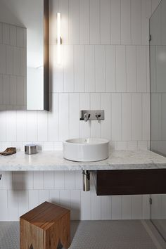 Adrian Amore Architects | Loft Apartment, West Melbourne Photographer: Fraser Marsden; alternative white subway tile layout, mosaic tile floor