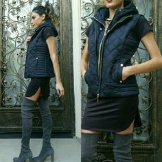 Navy blue vest with detachable hood New Quilted Navy Blue Vest with detachable hood. Has 2 pockets in the front, and snaps in the back to adjust waist. Lightweight, but a wind breaker. Perfect layering piece! Ppl comments say it looks way more expensive then the pics and more beautiful in person! New with tags! no trades boutique  Jackets & Coats Vests