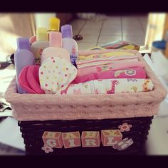 Baby shower DIY gift basket (girl) for LINDSAY'S baby shower! mariah will be happy(: