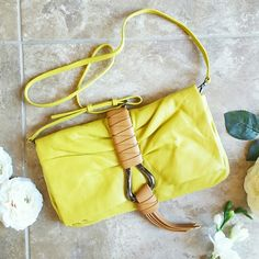 """Sale! Halston Heritage Convertible Clutch Lemonade A perfect pop of color! Sold out in stores and online- Beautiful, NWT Halston Heritage soft, Italian leather convertible clutch handbag in """"Lemonade,"""" a stunning shade of rich, lemon yellow. Flap- top with gunmetal accents, magnetic snap closure, exterior and interior slip pockets, detachable shoulder strap (w/ 22"""" drop) and leather fringe detailing. Approx. 7"""" in height, 12"""" in length and 1"""" wide. Ships w/ Halston Heritage dust bag. Halston…"""