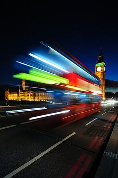 Here's another picture shot at a low shutter speed, this time with a double decker bus passing by the Big Ben. Because of the low shutter speed, the bus has sort of this neon light effect. Slow Shutter Speed Photography, Light Trail Photography, Movement Photography, Time Photography, Exposure Photography, Sport Photography, Abstract Photography, Street Photography, Photography Lighting