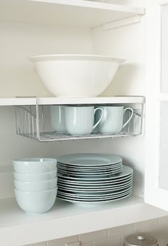 Create more space in kitchen cupboards with office wire racks.