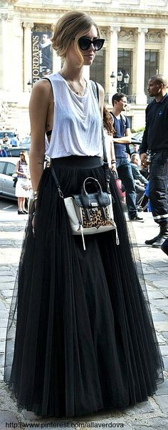 Not my usual style but I love this skirt, Id perfer is with like a crop top instead of the manly muscle tank...
