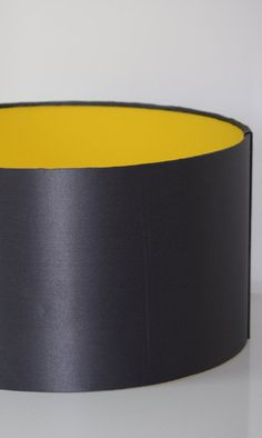 Charcoal Grey silk satin drum lampshade with yellow by TigerBeans Need 14 x 10 silver exterior charcoal interior. Yellow Fabric, Spare Room, Greenhouses, Silk Satin, Drums, Bedroom Ideas, Charcoal, Lounge, Shades