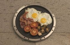 Frying pan for Cobb Portable Charcoal Grill.  It's teflon coated.