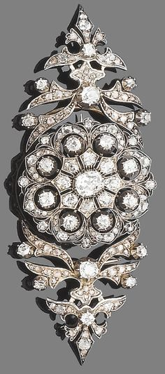 A late 19th century diamond brooch/pendant, circa 1880.  The brooch designed as a pierced circular plaque set throughout with old brilliant and rose-cut diamonds, mounted in silver and gold