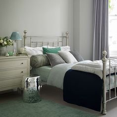 Pale grey bedroom with nickel bed. Calming silver accents will add understated glamour to a traditional bedroom scheme.  #Sleeptember