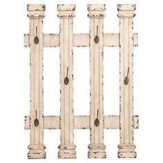 Picket fence-shaped wood and metal wall rack with hooks and a weathered finish.       Product: Wall rackConstruction Material: Wood and metalColor: WhiteFeatures: Functional designDimensions: 32 H x 23 W x 3 D