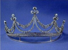 A late belle epoque garland style tiara, 1910, from Sweden. Designed as five bows, each topped with a circular diamond, connected to each other by both foliate and plain diamonds garlands, rising from a laurel leaf diamond base.