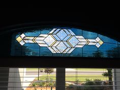 By Terry Bishop... Transom for kitchen window at our home in Florida. Steel blue