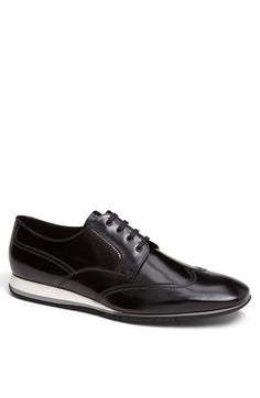 Free shipping and returns on Prada Wingtip Oxford at Nordstrom.com. Classic wingtip styling and meticulous topstitching define an essential oxford crafted from high-shine Spazzolato leather.
