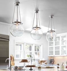The Hood. Clear glass shades in multiples create a clean look with impact.