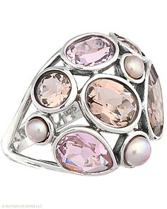 This Silpada ring might look real cool on!  A delightful bouquet of faceted stones nestled just-so. Glass, Pearl, Sterling Silver.