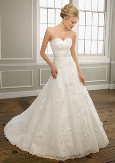 """Mori Lee by Madeline Gardner Style 1663 Duchess Satin and Organza with Floral Lace Appliques  Colors: White/Silver, Ivory/Silver. Available in three lengths: 55"""", 58"""", 61"""". Sizes Available: 2-28."""