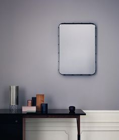 'Adnet Rectangulaire' mirror by Jacques Adnet reissued by Gubi / black leather