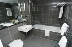 radisson hotel, cardiff, luxury, contemporary bathroom in grey. Radisson Hotel, Hotel Interiors, Wall Tile, Cardiff, Bathrooms, Tiles, Room Ideas, Flooring, Contemporary