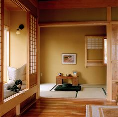 Japanese inspired house. I like that most of the house is flooring, but there is one tatami room. I also love the little reading nook with shoji doors for privacy, and roller blinds to block sunlight if you want to read when it's too sunny. From: http://www.eastwindinc.com/gallery.html