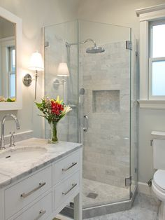 Epic Corner Shower Doors Glass Using Ceramic Wall And Floor: Admirable Corner Shower Doors Glass Using Single Shiwer And White Tile Wall And Floor Combined With White Vanity Unit And Marble Upper Side Completed With Flowers In Vase Also White Framed Mirror ~ crgrafix.com Bathroom Designs Inspiration