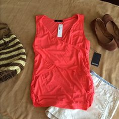 Sleeveless cross-front knit top. Sleeveless cross-front knit top.  Stylish details. Lovely coral color. 41Hawthorn Tops