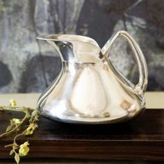 Love the lines of this pitcher.  Beautiful addition to anyone's kitchen or bar.  $138 at Simply Selma's