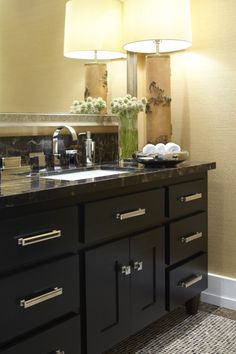 Cabinetry that looks like furniture with room for a lamp and other home touches.