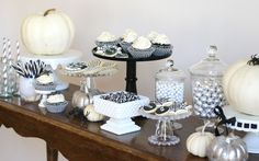 Give your Halloween party a more elegant look with this Black and White Halloween Dessert Table- perfect for a teen or adult Halloween party